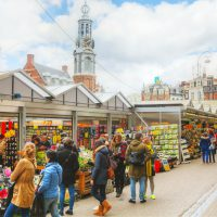 Amsterdam, The Netherlands - April 17, 2015: Floating flower market with people in Amsterdam, Netherlands. It?€™s usually billed as the ?€œworld?€™s only floating flower market?€.