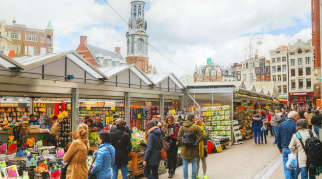 Amsterdam, The Netherlands - April 17, 2015: Floating flower market with people in Amsterdam, Netherlands. It?€™s usually billed as the ?€œworld?€™s only floating flower market?€.
